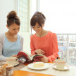 Japanese women at cafe - Stock Photo