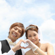 Royalty-Free Stock Photo: Japanese groom and bride making heart sign
