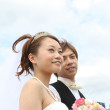 Royalty-Free Stock Photo: Japanese groom and bride with blue sky