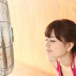 Japanese woman and an electric fan - Stock Photo