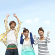 Group of young Japanese jumping - Foto Stock