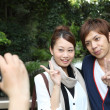 Japanese couple taking their own pictures - Foto de Stock