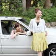 Royalty-Free Stock Photo: Japanese women with a car