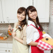 Japanese girls cooking in the kitchen - 图库照片
