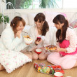 Japanese girls having snacks — Stock Photo