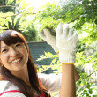 Japanese girl in the garden - Stock Photo