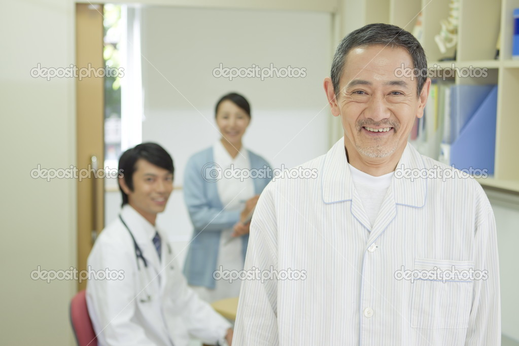 Senior Japanese patient in examination room — Stock Photo #15451339