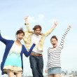 Group of young Japanese jumping - Stock Photo