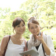 Japanese women using ipad - Foto Stock