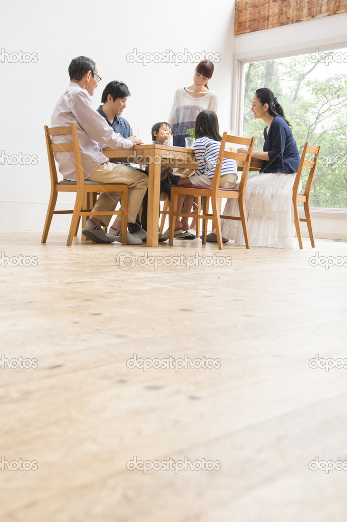 Japanese family gather at dining table — Stock Photo #17460083