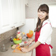 Woman cutting vegetables in kitchen - Stock Photo