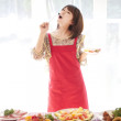 Woman eating seafood - Stock Photo