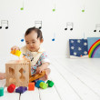 Baby boy playing with blocks - Stock Photo