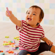 Baby boy playing with alphabets and numbers - Stock Photo