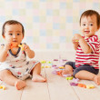 Baby girl and baby boy playing with alphabets - Stock Photo