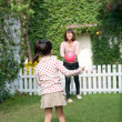 Girl playing with her mother in a lawn - Foto de Stock