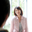 Woman talking to her husband smiling - Stock Photo