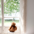 Teddy bear on a chair - Stock Photo