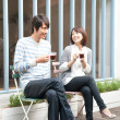 Royalty-Free Stock Photo: Young couple drinking tea smiling