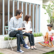 Family in a domestic garden - Stock Photo