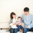 Baby boy with his parents - Stock Photo