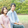 Young couple in a park - Stock Photo