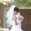Bride holding a bouquet - Foto Stock