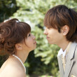 Side profile of a newlywed couple face to face - Stock Photo
