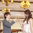 Young couple toasting with champagne in a restaurant - 图库照片