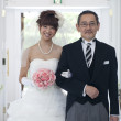 Bride with her father walking in church - ストック写真