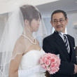 Bride with her father walking in church - Stock Photo