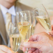 Human hands toasting with champagne - Stock Photo