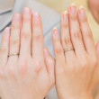 Newlywed couple showing their wedding rings - Stock Photo