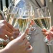 Wedding guest toasting with champagne at wedding reception - Stock Photo