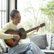 Senior man playing guitar — Stock Photo
