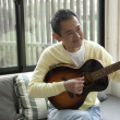 Senior man playing guitar - Foto de Stock  
