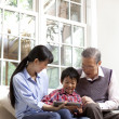 Family using digital tablet — Stock Photo