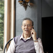 Senior man talking on a mobile phone - Stock Photo