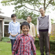 Family standing in a garden - Stock Photo