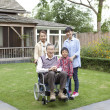 Family in a garden - Stockfoto
