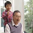 Senior man with his grandson - Stock Photo