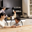 Family in a kitchen - Stock Photo