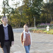 Senior couple walking in a park - Foto Stock
