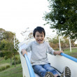 Boy on water slide - Stock Photo