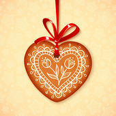 Vector gingerbread heart on red ribbon — Stock Vector