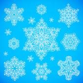 White snowflakes set on blue background — Stock Vector