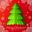 Green paper Christmas tree on red background — Stock Vector