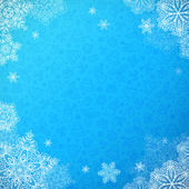 Blue snowy ornate background with snowflakes — Stock Vector