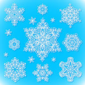 White snowflakes set on blue background — Stock Vector