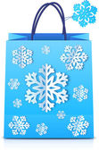 Blue Christmas shopping bag with paper snowflakes — 图库矢量图片